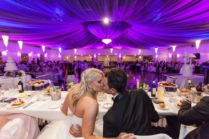 Bride and groom Kissing with purple lighting