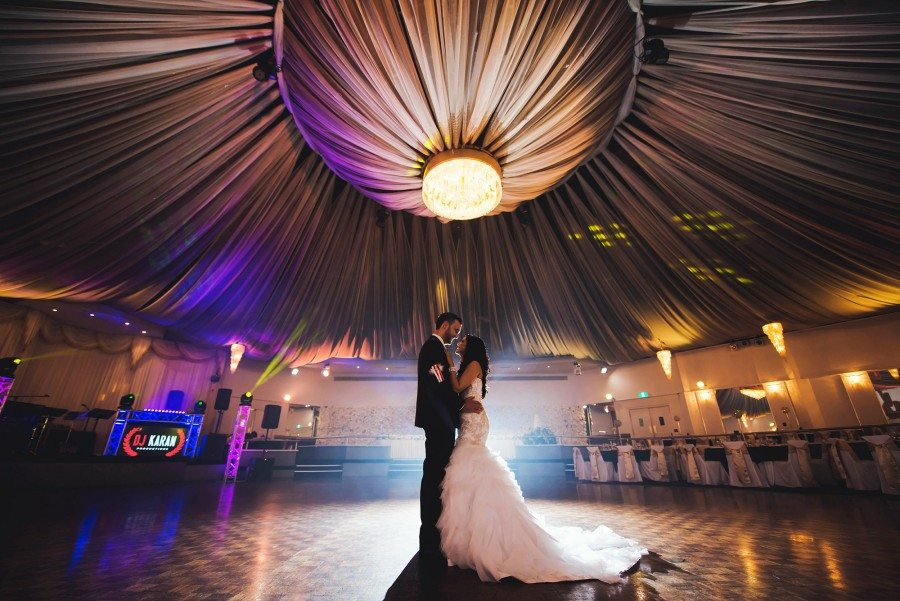 bride and groom alone under canopy