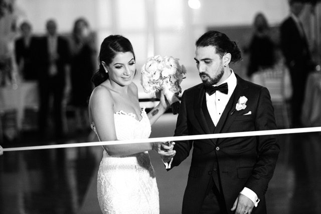 bride and groom cutting a ribbon