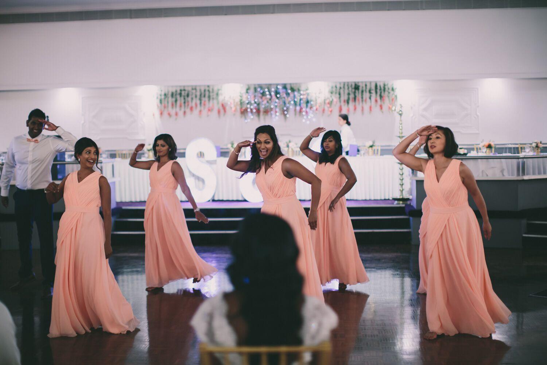 bridesmaids in peach dress dancing