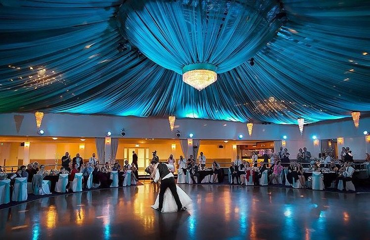 bride and groom dancing under canopy