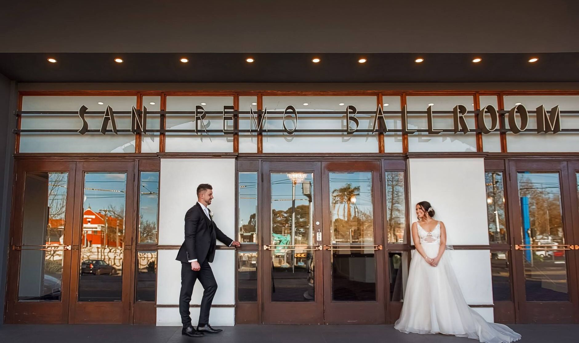 bride and groom at the entrance to San Remo Ballrooms