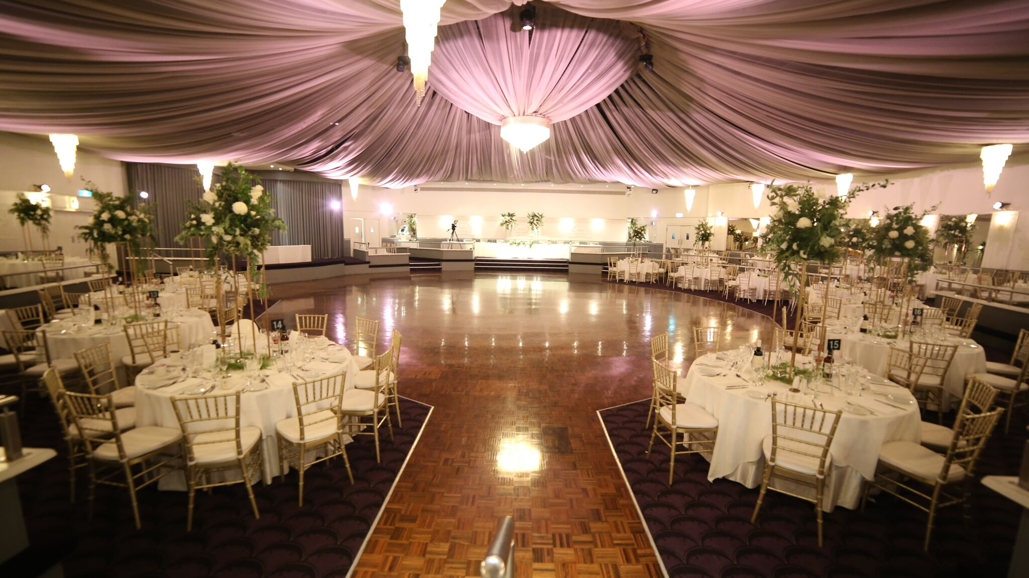 ballroom with canopy and tables for guests