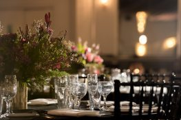 floral arrangement on black table