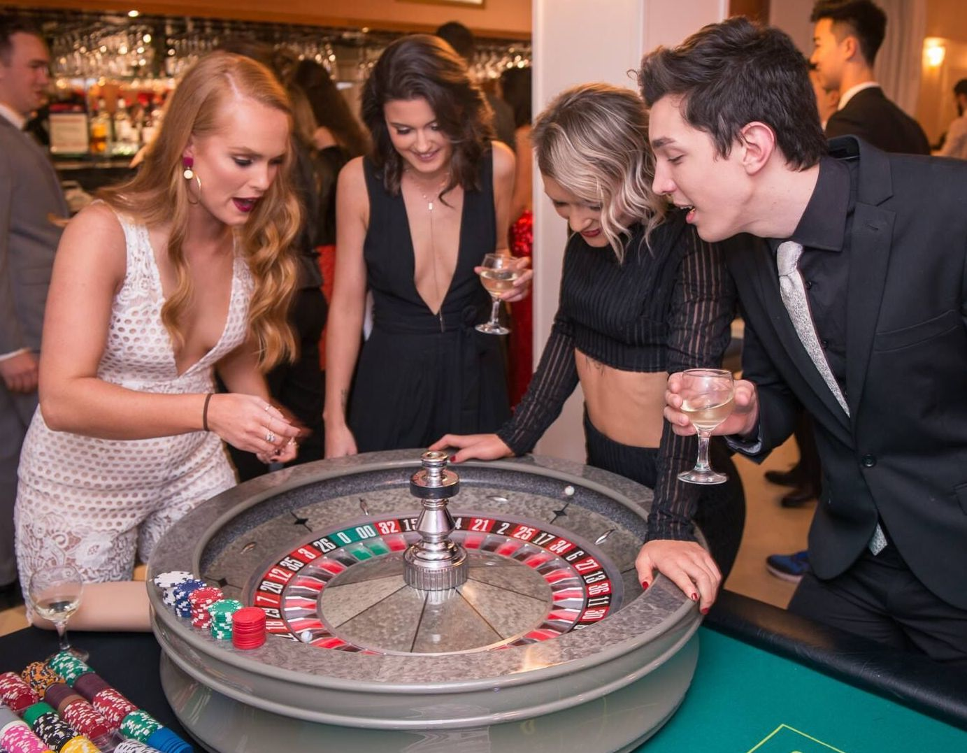 roulette table with players