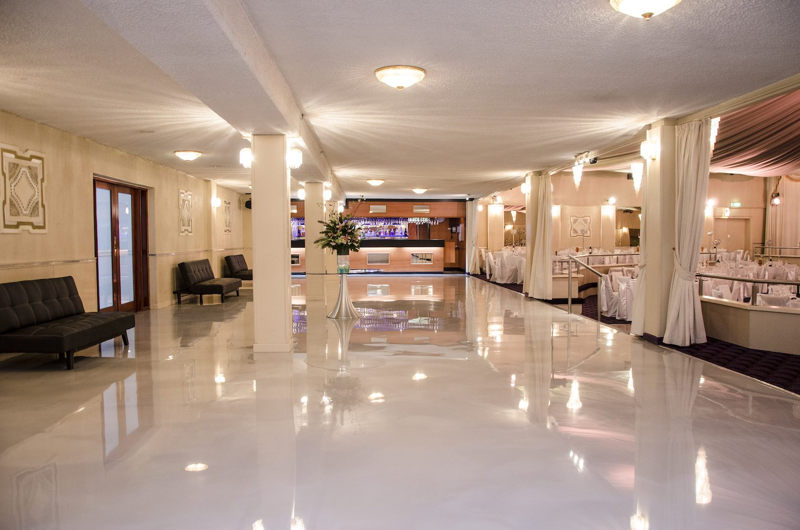 white marble floor with pillars