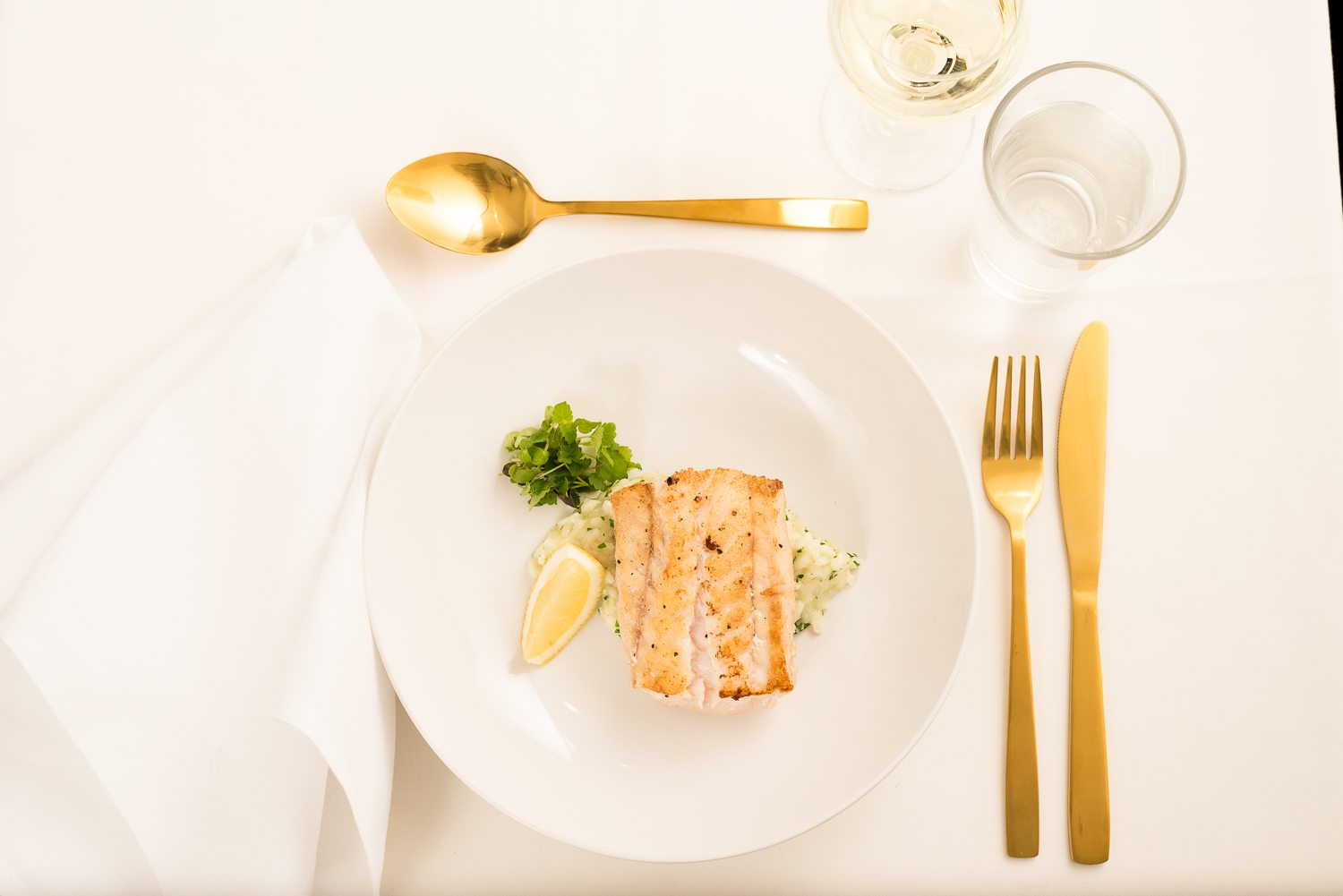 fish platter with gold cutlery